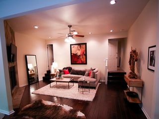 Austin townhome photo - Newly decorated, cozy, living area. Hand scraped wood floors, 52 inch plasma