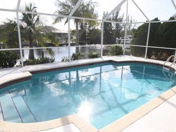 Cape Coral house rental - Southern exposure, electric heated pool, lanai and canal view.