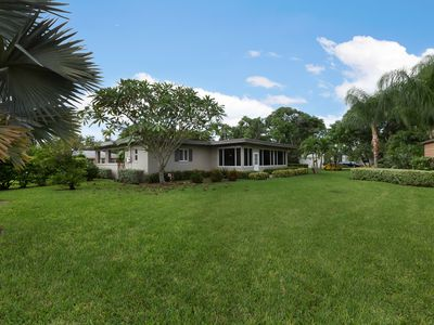 Huge half-acre yard with lots of palm trees, fruit trees, and room to stroll.