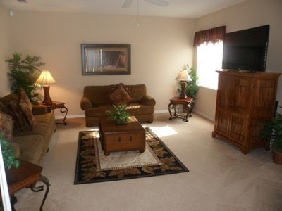 Family room with HDTV and access to the private pool