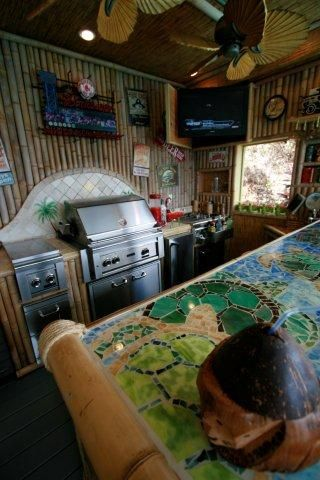 The Tiki bar comes stocked with a plasma TV, ice maker, refrigerator, and more..