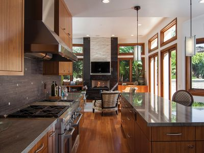 Kitchen opens up to a second living area and entertainment center.
