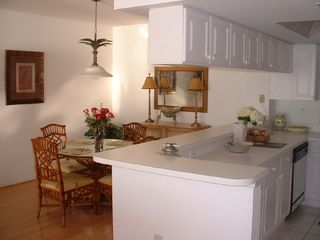 Vanderbilt Beach condo photo - Tommy Bahama Dining Area is Open To Kitchen with Gulf View