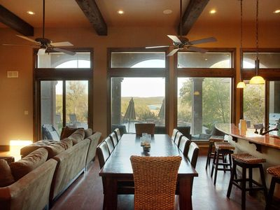 Dine with grand views of the pool and Lake Travis