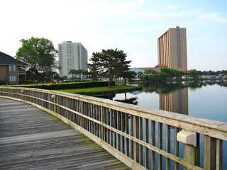 Kingston Plantation condo photo - Bridge crosses the natural lake to the Richmond Park swimming pool.