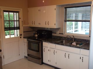 Sarasota house photo - Spacious kitchen with new appliances and eat in table for 4.