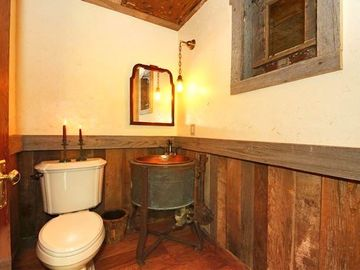Rustic bathroom with antique washtub copper sink