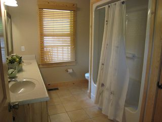 Beaver Lake house photo - King master bath. Double sinks and tub/shower combo.