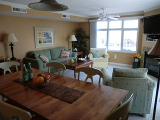 Bel Mare Ocean City condo photo - combined dining room/living room looking towards beach and boardwalk