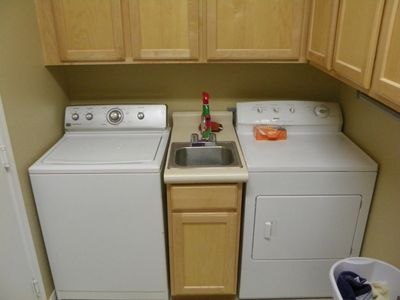 Large laundry room with storage.