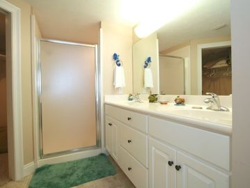 The Master Bath has a double vanity sink and a double head shower system.