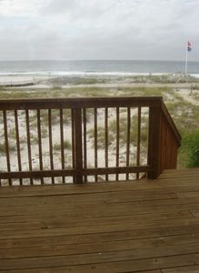 Walk out the door to private deck and down steps to sand and surf.