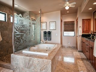 Kailua Kona house photo - Primary master bath with a walk through shower and Jacuzzi tub!