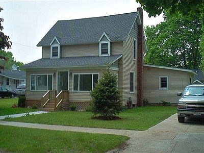 House with enclosed front porch, nice back yard and rear deck.