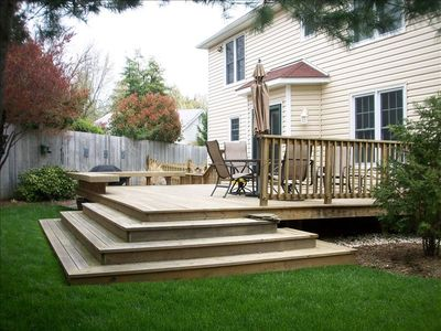 Backyard Deck with fenced yard. Outdoor dining table seats 6.
