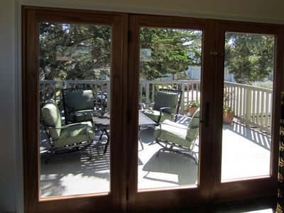 Deck/sun porch just off the master bedroom is a great spot for breakfast.