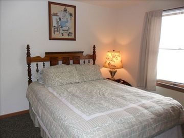View of 2nd guest bedroom with Queen bed.