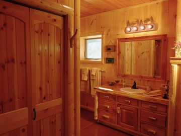 Master Bath in Basement with Custom Made Log Vanity and Large Closet