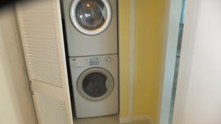 Galveston house photo - Stacked washer dryer in hall closet