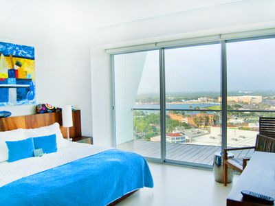 King size guest bed with view of the marina. Bed can be separated into 2 twins.