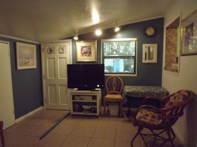 View 2 Den with flat screen t.v. Door leads to backyard with swing/BBQ area