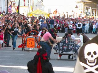 Eastport house photo - Water Street: The Bed Race, during Eastport's September Pirate Festival