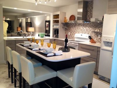 Gourmet Kitchen,fully equipped custom designed, seating 8 at island & counter