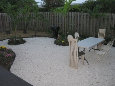 The back yard, great for BBQs, drinks, etc.. New patio furniture & bed soon.
