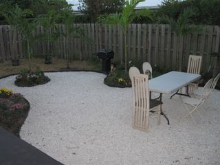 North Miami house photo - The back yard, great for BBQs, drinks, etc.. New patio furniture & bed soon.