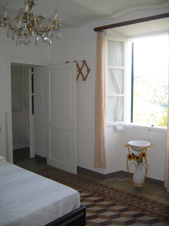 Master bedroom (doorway leads to balcony)