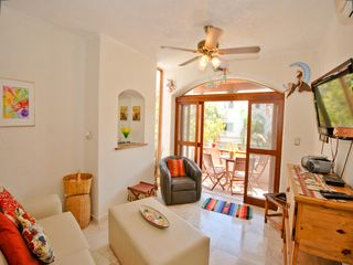 Playa del Carmen condo photo - Bright and cheery living area.
