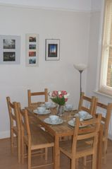 Greenwich apartment photo - Dining table (at other end of lounge) seats 6 as standard