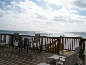 Stairs from Main Deck to white sand and water.