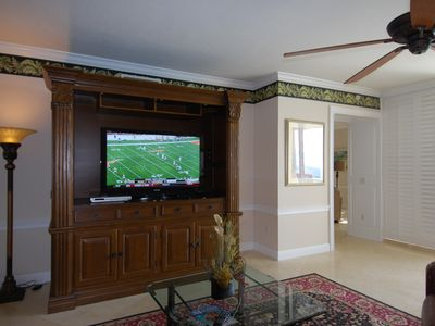 Watch your 55 inch HD TV in the living room while enjoying a Gulf of Mexico view