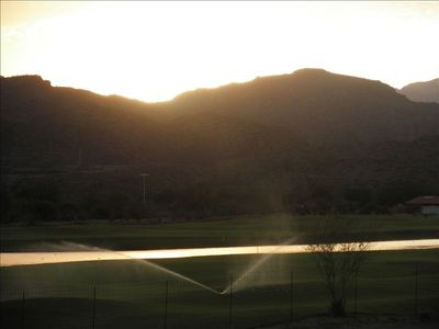 View from 3rd floor observation tower, 18 hole golf course, and mountain sunset