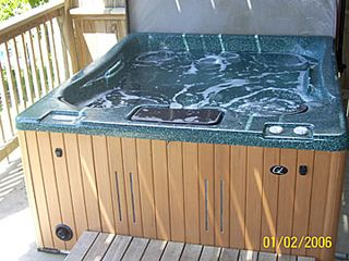 Dandridge cabin photo - hot tub over looking lake