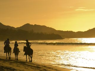 Playa Conchal condo photo - Horseback riding at sunset, simply amazing