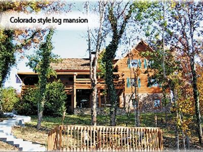 Custom made gated log mansion