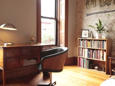 Harlem studio rental - Who knows what you will write on this antique desk? Wifi included.