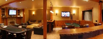 Downstairs entertainment including bar, pool table, poker, darts, and Wii