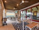 Outdoor living area - Enjoy some BBQ from the grill while going in and out of the pool!