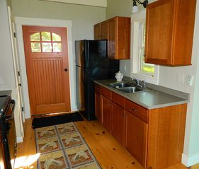 Partial view of the galley kitchen - Harpswell cottage vacation rental photo