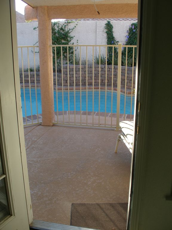 View of patio and pool from master bedroom door
