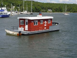 Georgetown house boat photo - The Island 40 with 15' dinghy and 4 hp 4 cycle outboard
