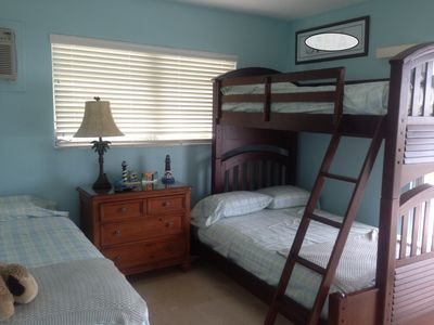 1 Full and 2 twin beds with Flat screen TV and balcony access