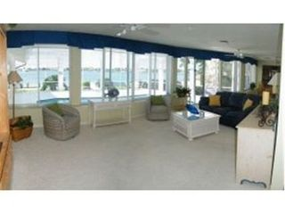 Vacation Homes in Marco Island house photo - Family room opens to lanai.