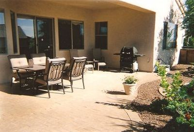 Back of house, patio, gas grill and pond with waterfall