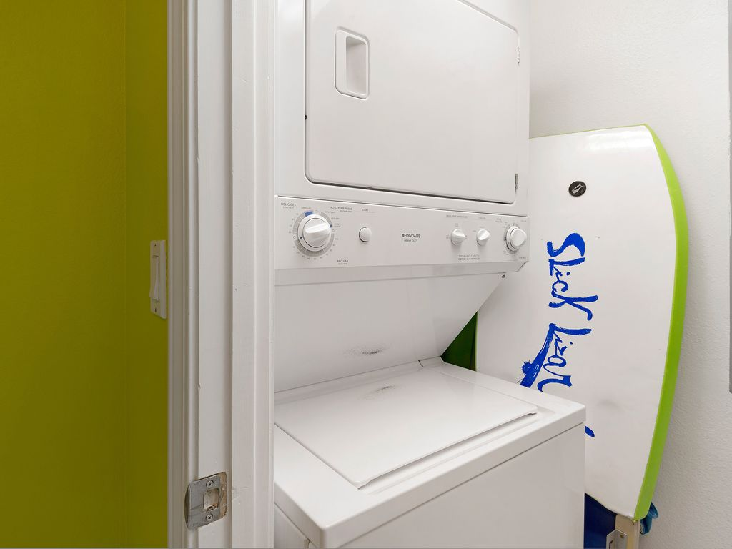 Stackable washer/dryer in unit. Enjoy use of the boogie board & 2 beach chairs