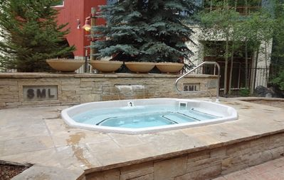 Silver Mill's large 16 person hot tub in the courtyard.