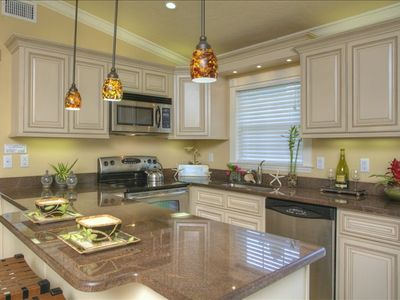 Enjoy the beauty of granite countertops and stainless appliances
